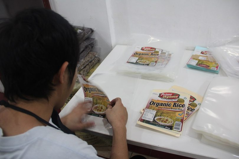10-worker-at-glowcorp-packaging-organic-rice